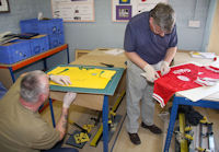 Sports jerseys are sewn into place.